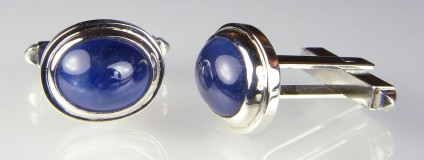 Cabochon sapphire cufflinks in gold - 13.09ct pair of cabochon cut blue sapphires set in 9ct white gold