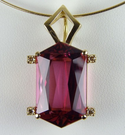 Rubellite pendant in gold - Scissor Cut Rubellite & Golden Diamond Pendant. Pendant of 17.34ct scissor cut rubellite (red tourmaline) set with 0.22ct golden diamonds in 18 carat yellow gold. 32 x 17mm.