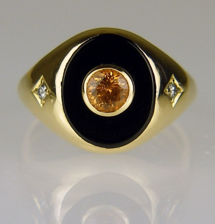 Man's onyx signet ring set with mandarin garnet - Onyx signet ring in 9ct yellow gold. This ring belonged to a customer's father and she wanted to feminise it to wear as a keepsake after he had passed away. Just Gems drilled the onyx and set it with a lively mandarin spessartine garnet (the father's birthstone).