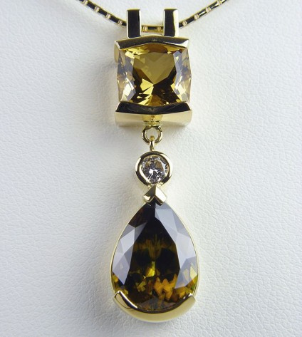 Sphene, diamond & golden beryl pendant in gold - Sphene, golden beryl & diamond Pendant. Pendant of 6.04ct pear shaped sphene set with 3.13ct radiant cut golden beryl and 0.2ct diamond in 18 carat yellow gold. 40 x 10mm.