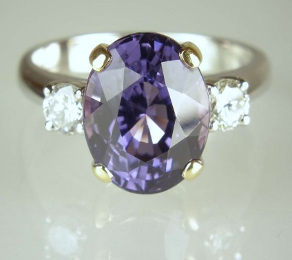 Spinel & diamond ring - 5.46ct oval cut lilac blue spinel set with 0.4ct matched pair of round brilliant cut diamonds in 18ct yellow and white gold handmade ring