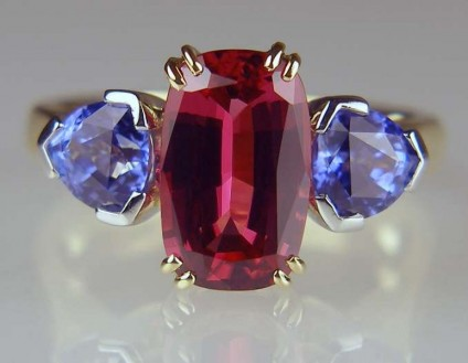 Red spinel and blue sapphire ring - Rectangular cushion cut red spinel set with a matched 1.29ct pair of trillion cut blue sapphires in platinum and 18ct yellow gold