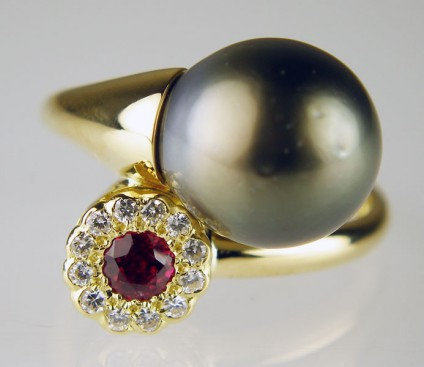 Tahitian pearl, ruby and diamond ring - !2mm round Tahitian pearl set with 3mm round ruby and 1.2mm round diamonds in 18ct yellow gold