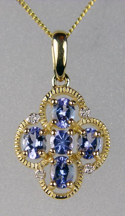 "Tanzanite & diamond pendant in 9ct yellow gold - Pretty and delicate tanzanite & diamond pendnat in 9ct yellow gold. Pendant measures 22x12mm. It hangs from an 18"" 9ct yellow gold chain."