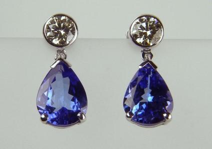 Tanzanite & diamond earrings - 0.71ct diamond pair in 18ct white rubover earstuds with 3.34ct pear cut tanzanite pair of detachable drops