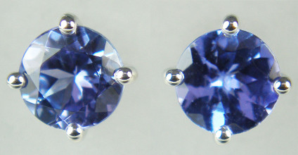 5mm tanzanite rounds set in 9ct white gold earstuds - 0.65ct pair of 5mm round tanzanites claw set in 9ct white gold earstuds