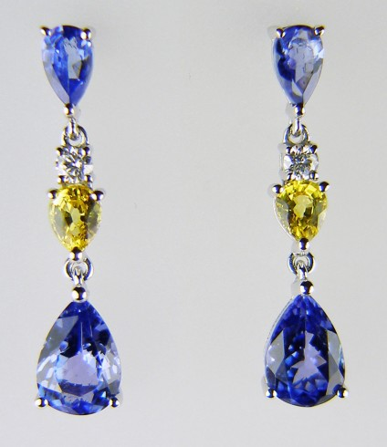 tanzanite,yellow sapphire & diamond drop earrings - Delicate drop earrings set with 1.82ct tanzanite pear cut pair of pairs, 0.39ct yellow sapphire pear cut pair and 0.06ct of round brilliant cut diamonds in 18ct white gold.