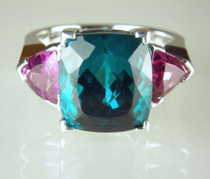 Tourmaline ring - 9.33ct superb teal coloured cushion cut tourmaline from Afghanistan flanked by a 1.58ct matched pair of trillion cut pink tourmalines in a handmade 18ct white gold ring