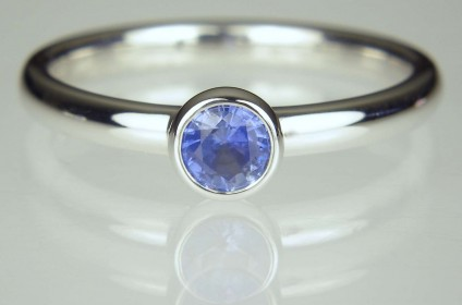 Sapphire Ring - 0.3ct round brilliant cut mod blue sapphire in delicate rubover set white gold ring