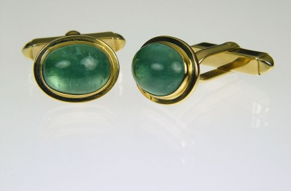Tourmaline cabochon cufflinks in gold - 10.23ct Tourmaline cabochon cufflinks in 9ct yellow gold. 15 x 12mm.