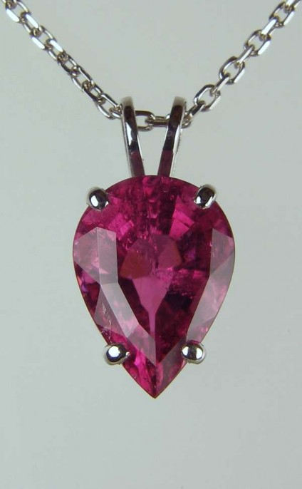 "Tourmaline pendant in platinum - 3.93ct pear cut deep red/pink tourmaline, mounted as a pendant in platinum and suspended from an 18"" platinum chain"