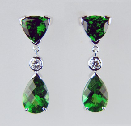 Tsavorite & diamond drop earrings in 18ct white gold - 1.16ct pair of trillion cut tsavorite garnets set with a 1.98ct pair of pear cut tsavorite garnets and 0.12ct of round brilliant cut diamonds all mounted as drop earrings in 18ct white gold