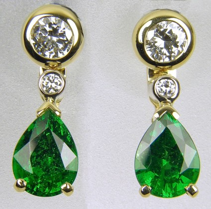 Tsavorite & diamond earrings - Pair of earrings consisting of 2 x 20pt diamond studs with detachable diamond and green tsavorite garnet drops in 18ct gold.