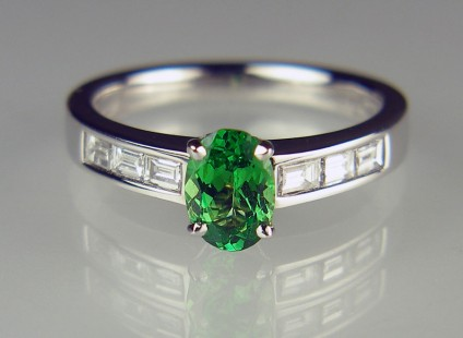 Tsavorite & diamond ring in 18ct white gold - 0.78ct oval cut tsavorite garnet set with 0.28ct baguette cut diamonds in 18ct white gold