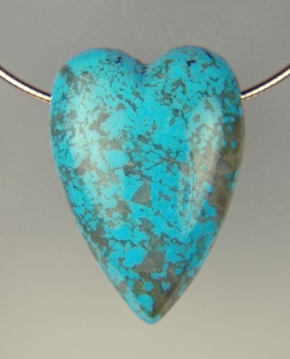 Kingman mine turquoise heart - Arizona turquoise heart from the Kingman mine, carved by David Horste, and suspended from a rose gold plated silver cable. The heart measures 42 x 30 x 17.8mm. Unique, beautiful, handmade.