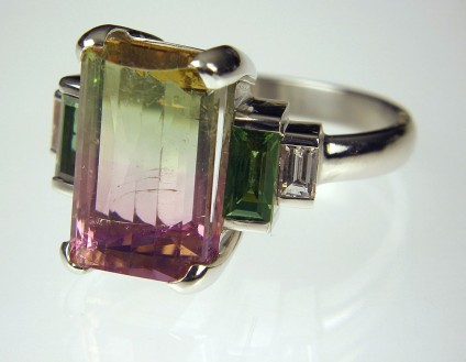 Watermelon Tourmaline & Chrysoberyl Ring - Watermelon tourmaline ring. Ring of 6.79ct watermelon tourmaline set with 0.84ct matching pair of baguette cut green chrysoberyls and 0.16ct baguette cut diamonds, in platinum.