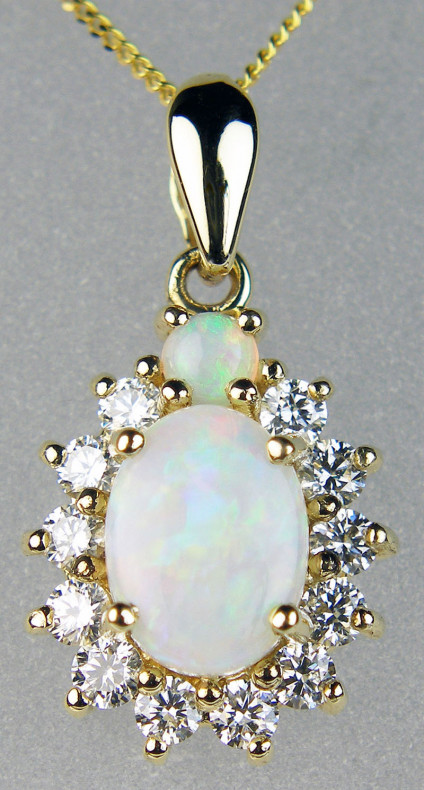 """Opal & diamond pendant in 9ct yellow gold - 1.363ct oval white opals set with 0.32ct diamonds in 9ct yellow gold suspended from an 18"""" 9ct yellow gold chain"""