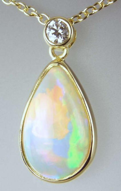 Opal & diamond pendant - 1.98ct pear cut cabochon white opal set with 0.07ct FG/VS diamond in 18ct yellow gold on adjustable 18ct yellow gold chain