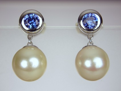 Sapphire & Pearl earrings - Round brilliant cut sapphire pair 0.56ct total weight set asstud earrings with detachable pearl drops.  The pearls were chosen to match the customer's Granny's pearl necklace.  The studs can be worn with or without the pearl drops.  In 18ct white gold.