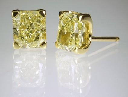 Yellow diamond earrings in gold - Yellow Diamond Earrings 5ct total radiant cut fancy intense yellow diamond (GIA certificated) earrings in 18ct yellow gold.