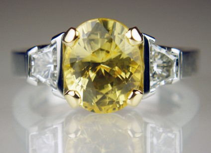 Yellow sapphire & diamond ring in platinum - 4.09ct oval yellow sapphire, natural and unheated, set with a matched pair of 0.62ct trapeze cut diamonds in G colour VS clarity, mounted in platinum