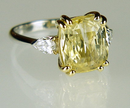 Yellow sapphire & diamond ring in 18ct yellow & white gold - 5.24ct natural yellow sapphire, unheated, cushion cut and flanked by a 0.41ct matched pair of pear cut diamonds in F colour VS clarity and mounted in 18ct yellow and white gold.
