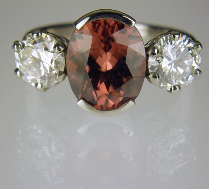 Zircon & diamond ring in platinum - Ring of 3.06ct Tanzanian pinkish brown oval zircon set with a 2 x 0.7ct I/SI1 diamonds in platinum.