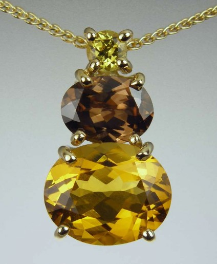 Golden beryl, zircon & garnet pendant - 2.99ct oval cut golden beryl, set with 1.61ct brown zircon from Myanmar, and 0.2ct Mali garnet in 18ct yellow gold