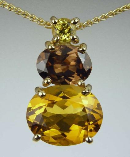 Golden beryl, zircon & garnet pendant - 2.99ct oval cut golden beryl, set with 1.61ct brown zircon from Myanmar, and 0.2ct Mali garnet in 18ct yellow gold